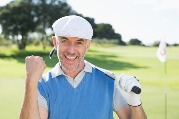 happy-golfer-cheering-at-camera-on-putting-green_13339-61536
